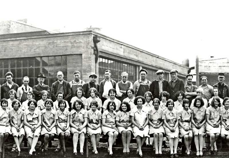 COURTESY OF OREGON WORSTED ARCHIVES AND NANCY BISHOP - These ladies are shown with other employees of the Oregon Worsted Company, happily posing in front of the wool factory at about 24th (today McLoughlin) and Tacoma Street in the 1920s. Oregon Worsted was one of the businesses in Sellwood that allowed women the independence and confidence of managing their own career. Ladies could also find employment at The Peerless Laundry Company, Bishop Brothers clothing store, or The Sellwood Millinery.