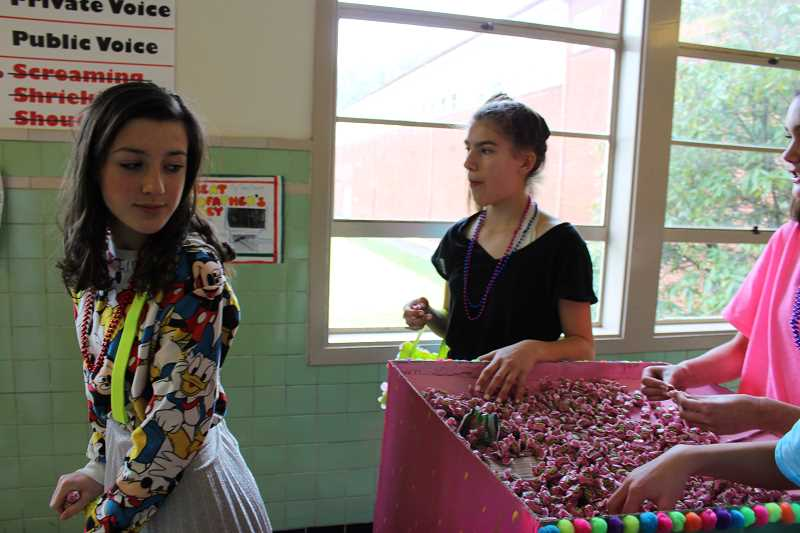 "Eighth-grade students at Robert Gray Middle School dressed up in colorful costumes to accompany their floats. Their instructor says they like ""to let their creativity flow.""  Of course, it doesn't hurt that candy is usually involved."