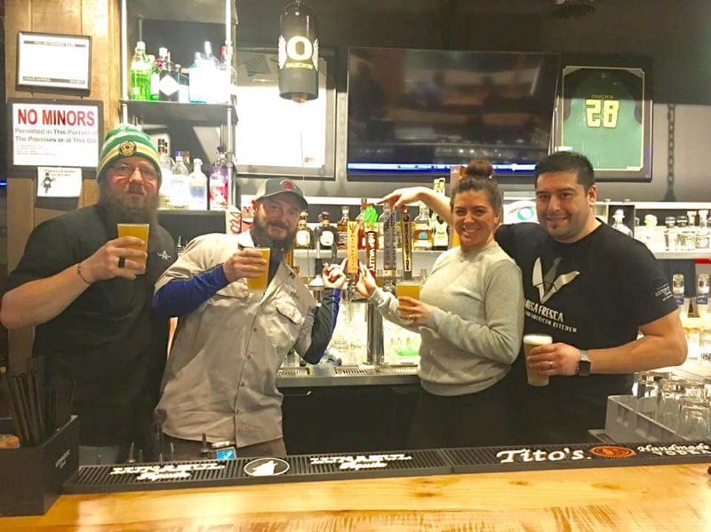 SUBMITTED PHOTO - From left, Ryan Jeske and Brandon Neldner, co-owners of Shattered Oak Brewing, and Kara Castillo and Roy Galvan, co-owners of Mesa Fresca, share a glass of Shattered Oaks Three Knives Lager, made with the restaurants cilantro-lime sauce.