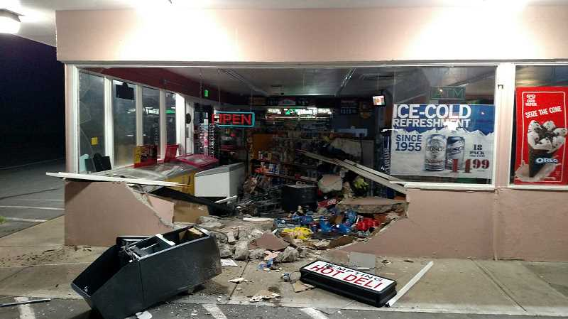 Driver crashes pickup into Brooks market, steals ATM