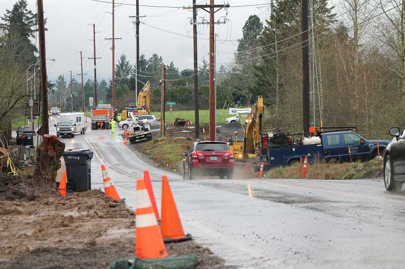 SPOKESMAN PHOTO: CLAIRE GREEN - Construction crews worked through rain and shine to put down sewage lines for the new Meridian Creek Middle School across the intersection of Wilsonville/Boeckman/Stafford/Advance March 20-24.