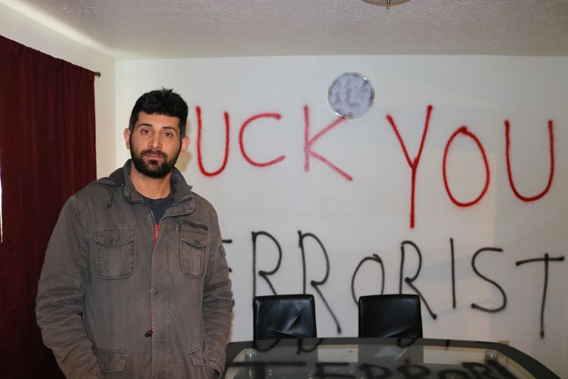 OUTLOOK PHOTO: ZANE SPARLING - Hasel Afshar, 33, poses for a photo inside his home on Wednesday, March 29.