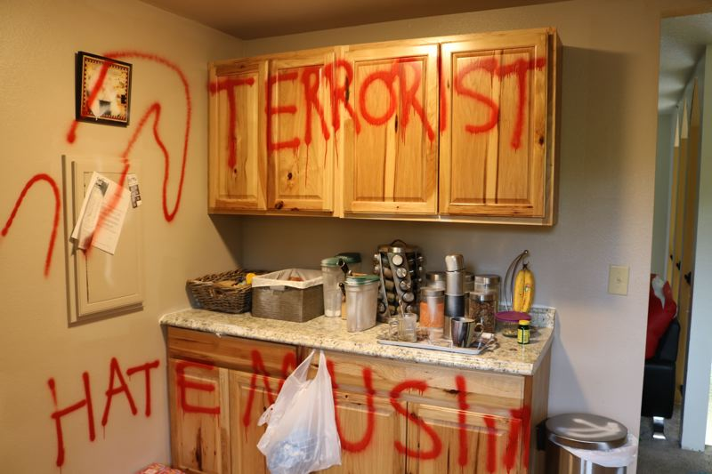 OUTLOOK PHOTO: ZANE SPARLING - This anti-muslim graffiti was spraypainted in Hasel Afshar's home. Afshar returned from his vacation to find the door locked.