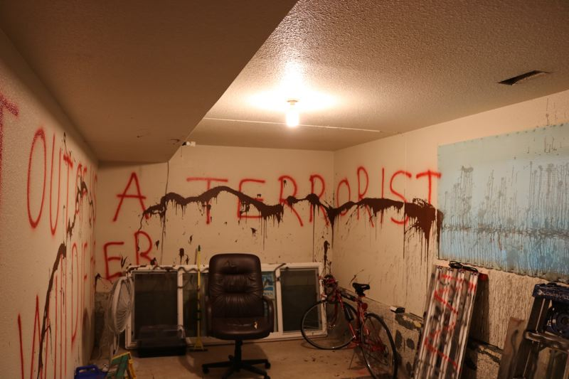 OUTLOOK PHOTO: ZANE SPARLING - More hateful graffiti at Hasel Afshar's house.