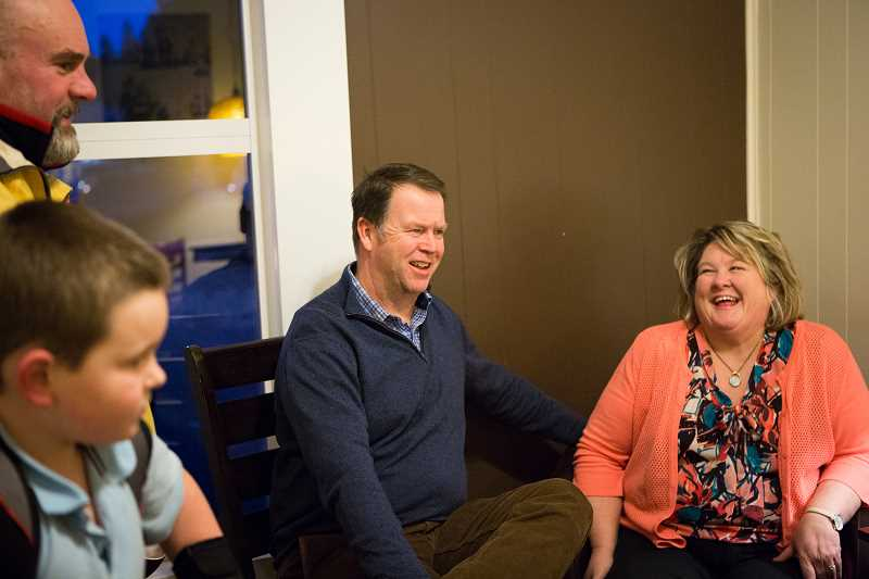 PAMPLIN MEDIA GROUP: ADAM WICKHAM - Phil and Lisa McGuigan share a laugh inside Symposium Coffee Sherwood. The couple has been a fixture in the community since they moved here in the late 1990s.