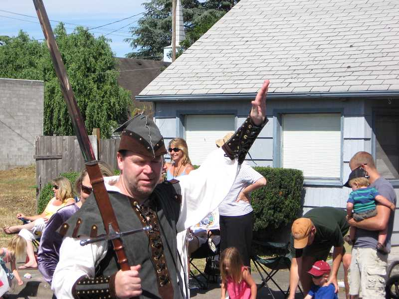 FILE PHOTO - Dressed as Robin Hood, Phil McGuigan marches along in the annual parade which draws thousands to Old Town Sherwood each summer.