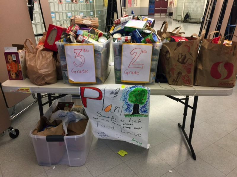 STAFF PHOTO: BLAIR STENVICK - Volunteers have been helping out, collecting and distributing food for students whose families don't have enough.