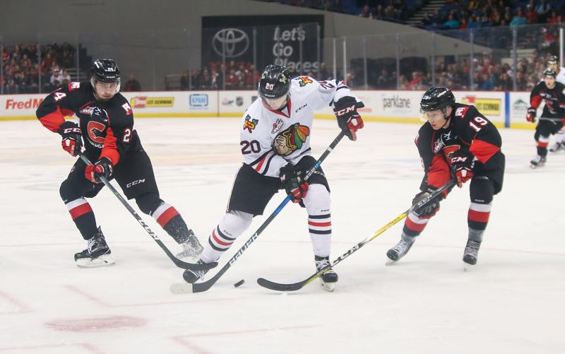 COURTESY: DAYNA FJORD - Portland Winterhawks forward Joachim Blichfeld takes the puck up the ice in Game 3 of a first-round playoff series against the Prince George Cougars on Wednesday at Memorial Coliseum.