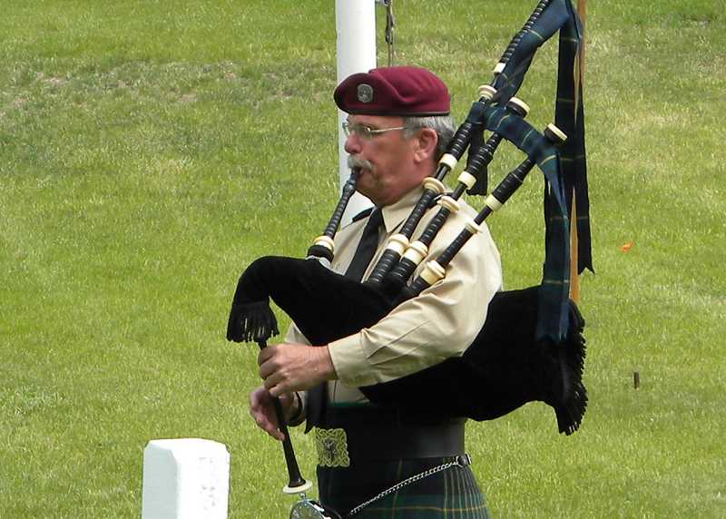 PHOTO COURTESY OF JOHN PIERSON - John Pierson plays the bagpipes at a military funeral in Juniper Haven Cemetery in Prineville. He began playing the pipes after looking for a way to publicly and significantly honor veterans killed in the line of duty.