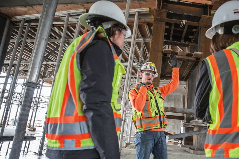 PAMPLIN MEDIA GROUP: JON HOUSE - Carpenter foreman Jeremy Harteloo talks about the steel structural support, both temporary and permanent, at the Knight Cancer Research Building.