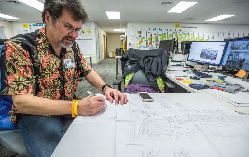 PAMPLIN MEDIA GROUP: JON HOUSE - Ed Trotter goes over architectural plans for the Knight Cancer Research Building.