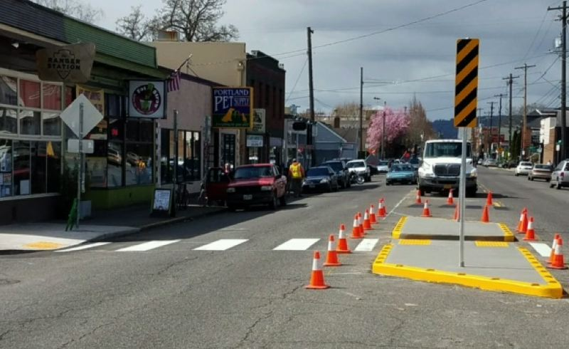 PBOT/KRISTEN BYER - A new crosswalk and pedestrian refuge island at Southeast Hawthorne and 43rd Avenue.