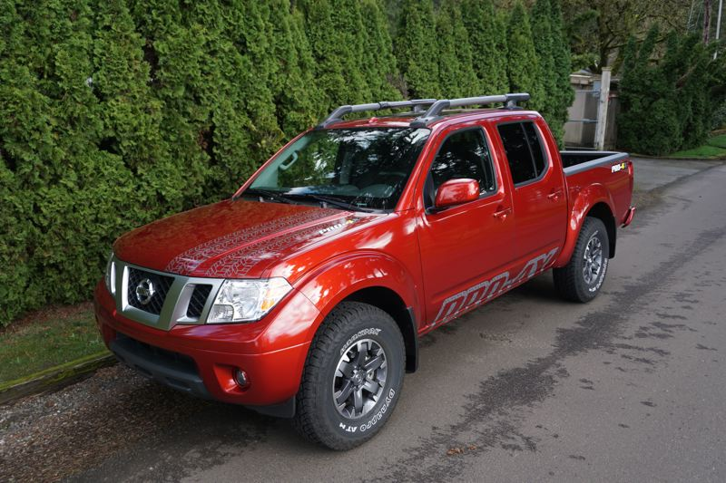 """PORTLAND TRIBUNE: JEFF ZURSCHMEIDE - When Nissan says """"PRO-4X"""" they mean it. You get skid plates underneath all the sensitive areas of the truck, tow-hooks, adjustable tie-down cleats in the bed, and a standard spray-in polyurethane bed liner — and that's just for starters."""