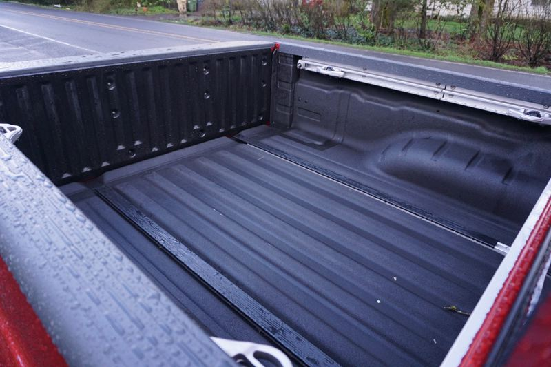 PORTLAND TRIBUNE: JEFF ZURSCHMEIDE - With the crew cab, the bed is 59.5 inches long, just a half-inch short of 5 feet.