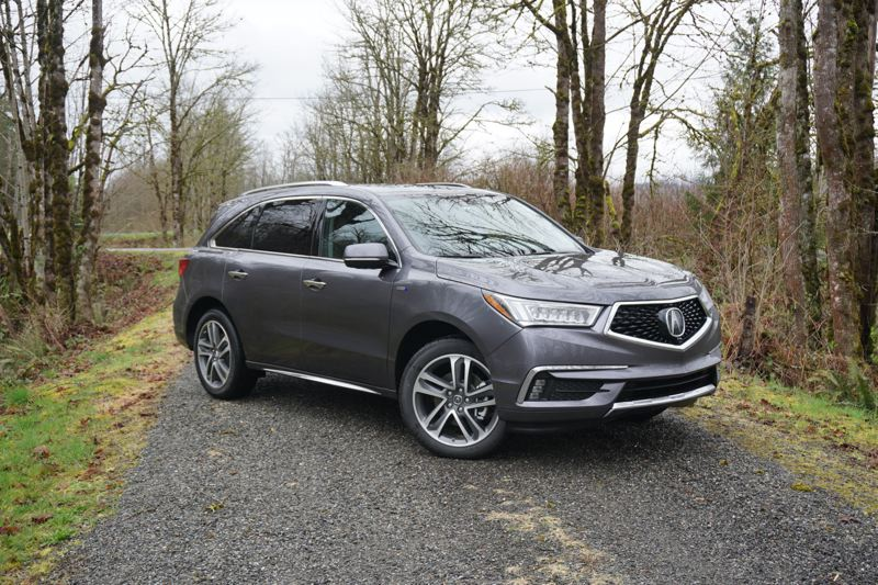 PORTLAND TRIBUNE: JEF ZURSCHMEIDE - The 2017 Acura MDX Sport Hybrid starts with a 3.0-liter V6 engine and a conventional hybrid electric motor to drive the front wheels. Then the rear wheels are driven by a pair of electric motors, giving you all-wheel-drive without a driveshaft connecting the front and rear wheels.
