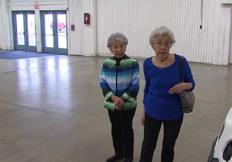 KOIN 6 NEWS - Taka Mizote, left, and Aya Fujii walk through the Portland facility on March 29 where they were brought in 1942 during a round-up of Japanese-Americans.