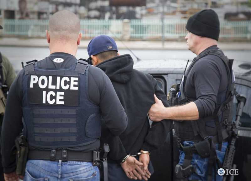 COURTESY PHOTO: U.S. IMMIGRATION AND CUSTOMS ENFORCEMENT - U.S. Immigration and Customs Enforcement officials do not wear uniforms but sometimes wear jackets or vests with the acronym identifying their agency.