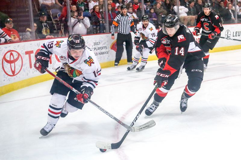 COURTESY: DAYNA FJORD/PORTLAND WINTERHAWKS - Portland Winterhawks forward Ryan Hughes rushes toward Prince George's Colby McAuley in Game 6 of the first-round series against the Cougars at  Memorial Coliseum on Monday.