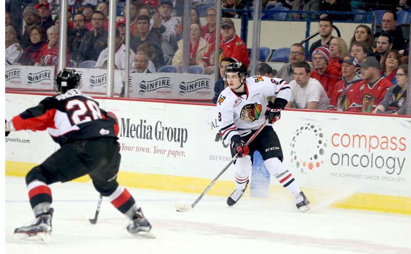 COURTESY: DAYNA FJORD/PORTLAND WINTERHAWKS - Cody Glass (right) and the Portland Winterhawks will open a playoff series at Kelowna on Friday.