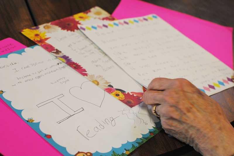 NEWS-TIMES PHOTO: STEPHANIE HAUGEN - Gaston Elementary students fill the letters to their Forest Grove pen pals with color, drawings, stories and questions.