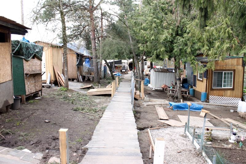 PORTLAND TRIBUNE: LYNDSEY HEWITT - Tents have been upgraded to simple wooden structures at the Hazelnut Grove homeless village in North Portland, but many neighbors want the encampment gone.