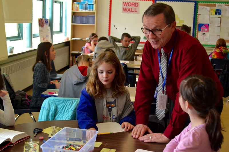 POST PHOTO: BRITTANY ALLEN - Don Brown teaches his fourth-grade class about government by having them create a mock United Nations.