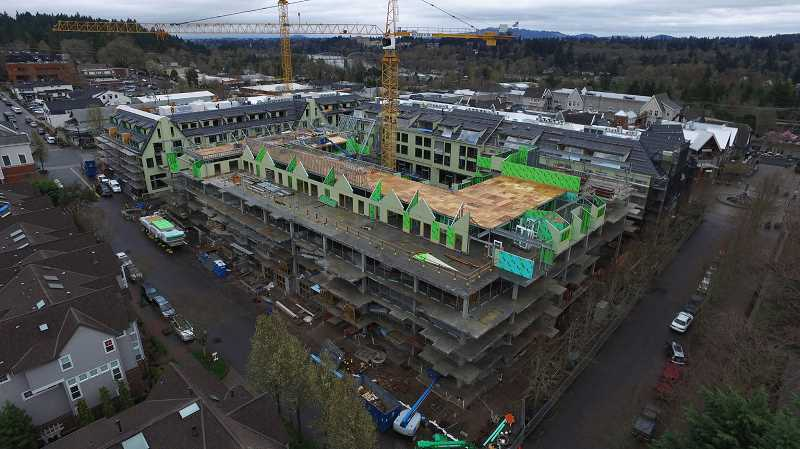 REVIEW PHOTO: ALVARO FONTAN - March 29, 2017: Building B along Second Street still looks more like a construction site than a mixed-use development, but crews are making progress on walls and framing for the roof.