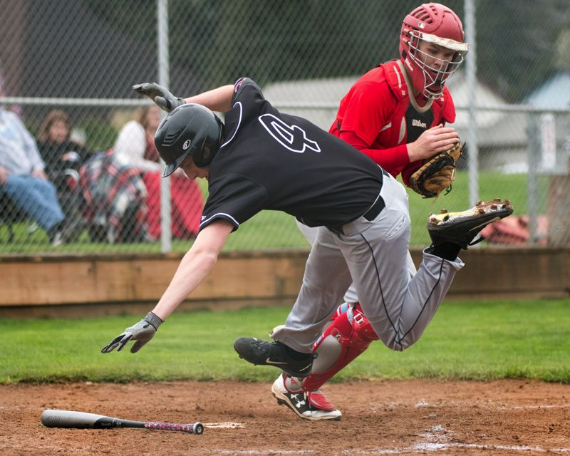 OUTLOOK PHOTO: JOSH KULLA - Oregon City outfielder Justin Wood is tagged out in a big collision at home plate Wednesday with Centennial catcher Rhys Atkinson in the Pioneers' 6-2 win at Centennial High School.