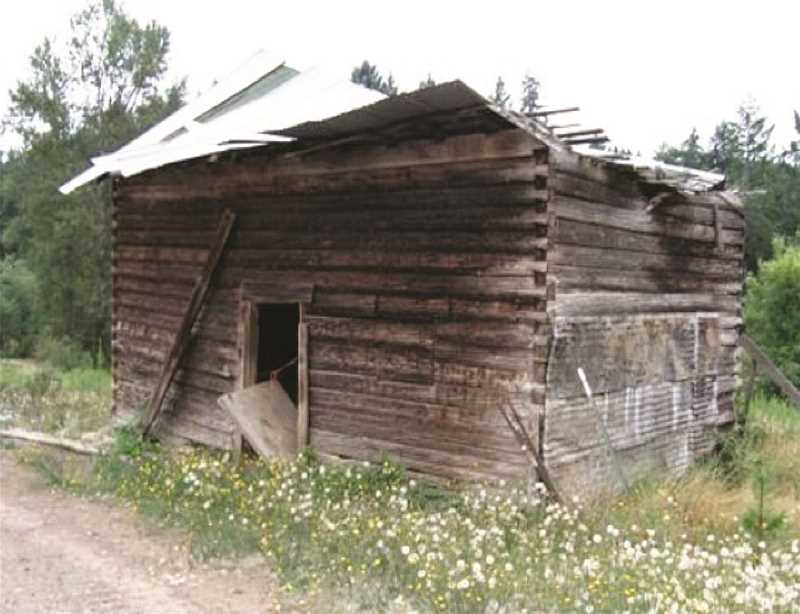 PAM HAYDEN - Molalla Log House before it was moved for restoration. This may be Oregon's oldest house, estimated to have been built in the late 1790s by Russian pioneers.