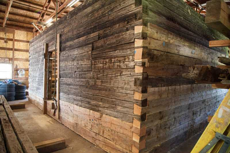 PAM HAYDEN - Molalla Log House during restoration in a Mulino storage building. Photo shows detail of the dovetail corners.