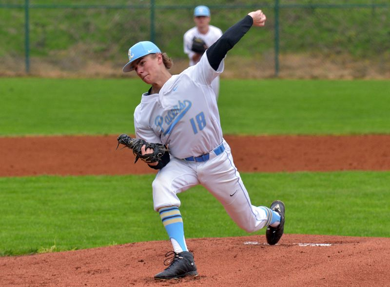 PMG PHOTO: COREY BUCHANAN - Lakeridge's Chris Simons gets ready to release a pitch during his team's 2-1 win over Canby at Lakeridge High School on Wednesday.