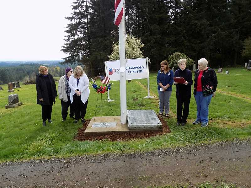 GAZETTE PHOTO: RAY PITZ - Members of the Champoeg Chapter of the Daughters of the American Revolution listen to Lois Streimer, a charter member of the Champoeg chapter, read the poem 'In Flanders Fields,' a tribute to those who died during World War I.
