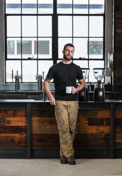 TRIBUNE PHOTO: JONATHAN HOUSE - Matt Higgins, sole owner and CEO of Coava coffee roasters, stands in the companys new headquarters at Southeast 10th Ave and Main St. Higgins decided to buy the space to host his office and production facility, because Central East Side commercial rents were being driven up by indoor cannabis growing operations, amongst others. Why pay $2.50 a foot for production space? asks Higgins.
