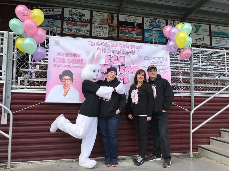 COURTESY OF LESLIE MCCABE - This years Egg Hunt for Hope raised more than $23,000 for Lorie Rainey, a Sherwood mother battling cancer. Shown here are the Easter Bunny, Rainey and the annual sponsors of the event, Leslie McCabe and Todd McCabe.