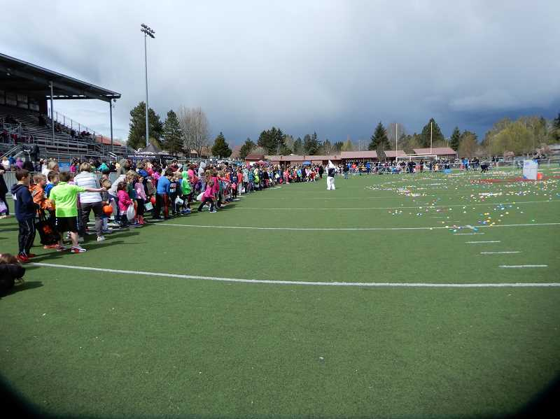 COURTESY OF LESLIE MCCABE - Participants in the 11th McCabe Real Estate Groups Annual Benefit Egg Hunt for Hope line up at the Sherwood High School football field for the event.
