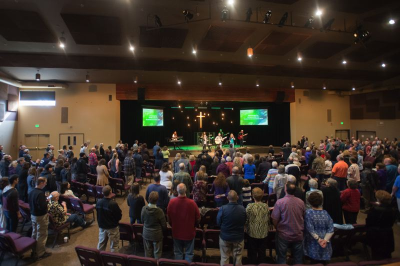 OUTLOOK PHOTO: JOSH KULLA - Hundreds of worshipers pack a recent Sunday morning service at Grace Community Church. There are four services each Sunday, including one in Spanish.
