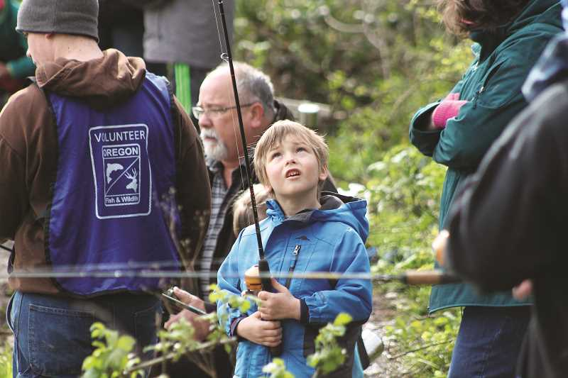 CONNER WILLIAMS - ODFW and volunteers were on hand to offer angling tips