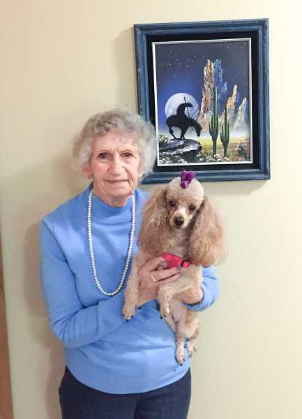 ESTACADA NEWS PHOTO: EMILY LINDSTRAND - Carlyn Alatorre and her 3-year-old dog, Reba, live at Grace Place Senior Living in Estacada.