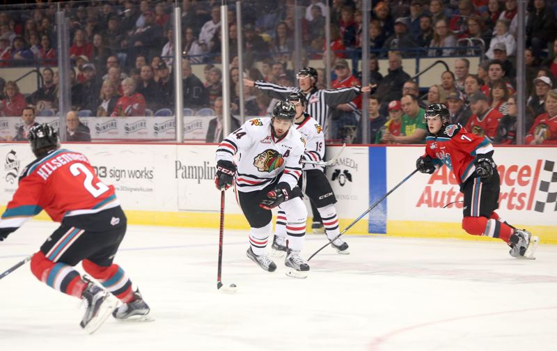 COURTESY: BRYAN HEIM/PORTLAND WINTERHAWKS - Portland Winterhawks defenseman Keoni Texeira handles the puck in Game 3 of the Western Conference semifinal series against the Kelowna Rockets on Tuesday at Memorial Coliseum.