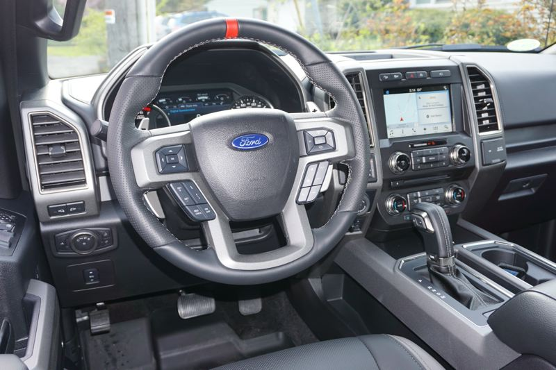 PORTLAND TRIBUNE: JEFF ZURSCHMEIDE - For all of its off-road toughness, the Raptor is also comfortable inside, with every modern convenience.  Heated leather upholstery, the SYNC3 infotainment system, and all the usual luxury features are there.