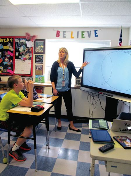 PHOTO BY ELLEN SPITALERI - Jody Bean, a sixth grade teacher at Gardiner Middle School in Oregon City, uses her SMART Board to show her class what a Venn diagram looks like.