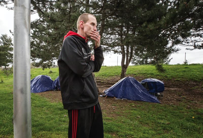 TRIBUNE PHOTO: JONATHAN HOUSE - Jason Townsend lives in a tent off the I-205 Multi-Use Path in Lents. He moved to Portland from Detroit, Michigan, about a year ago and often injects drugs, but says he will take his needles to an exchange.