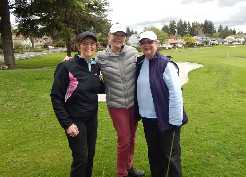 REGAL COURIER PHOTO: BARBARA SHERMAN - A week after the Summerfield Women's Golf Club opening luncheon, (from left) Ann Uphoff, Barbara Kelley and Jan Anderson play golf April 20 before the rain hit the Summerfield Golf Course.
