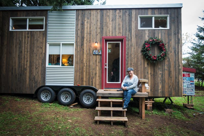 PHOTO BY BRIAN BURKE, COURTESY OF MICHELLE BOYLE  - Michelle Boyle sits on the porch of her tiny house outside Sherwood.