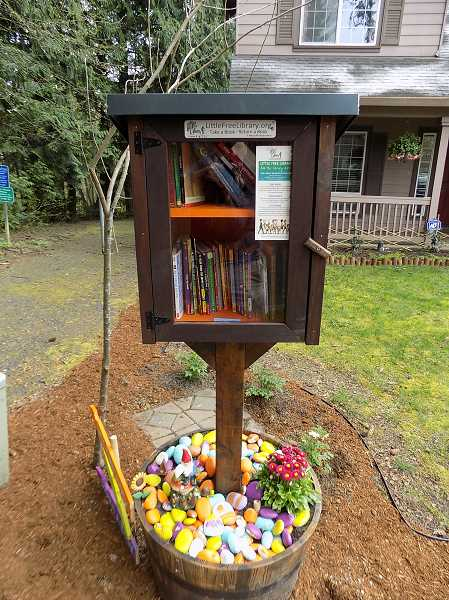 GAZETTE PHOTO: RAY PITZ  - The new Little Free Library on Redfern Drive marks at least the third of its kind in the city.