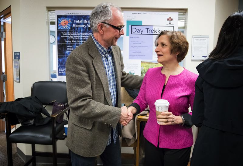 TIMES PHOTO: JONATHAN HOUSE - Tualatin Mayor Lou Ogden, left, greets U.S. Rep. Suzanne Bonamici at the Juanita Pohl Center on Monday. Bonamici met with the Tualatin Area Aging Task Force and then the America's Best Communities team for Tualatin.