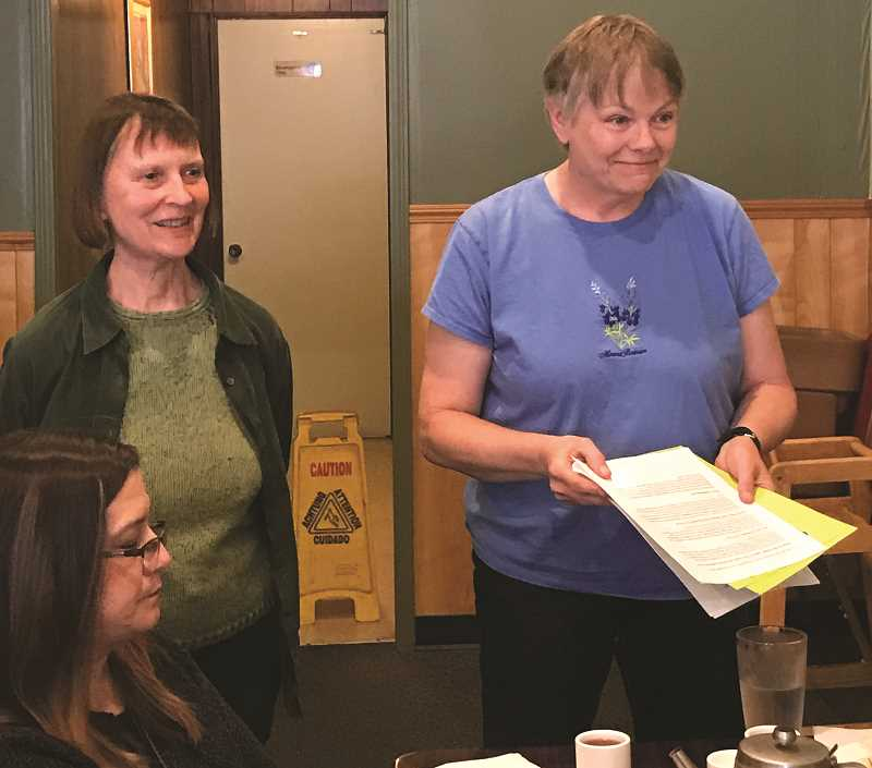 CHARLIE WILLIAMS - Marilyn Bloch, left, and Paula Beck present an overview of Molalla Aquatict District Measure 3-516 to members of the Molalla Kiwanis last Wednesday.