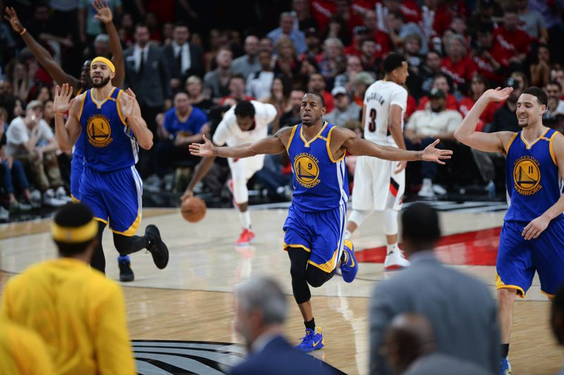 TRIBUNE PHOTO: JOSH KULLA - The Golden State Warriors celebrate their comeback victory on Saturday.