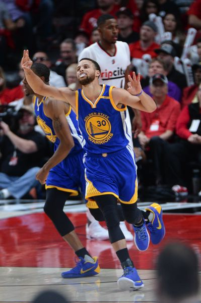 TRIBUNE PHOTO: JOSH KULLA - Stephen Curry enjoys a basket for the Golden State Warriors in Game 3 on Saturday night at Moda Center.