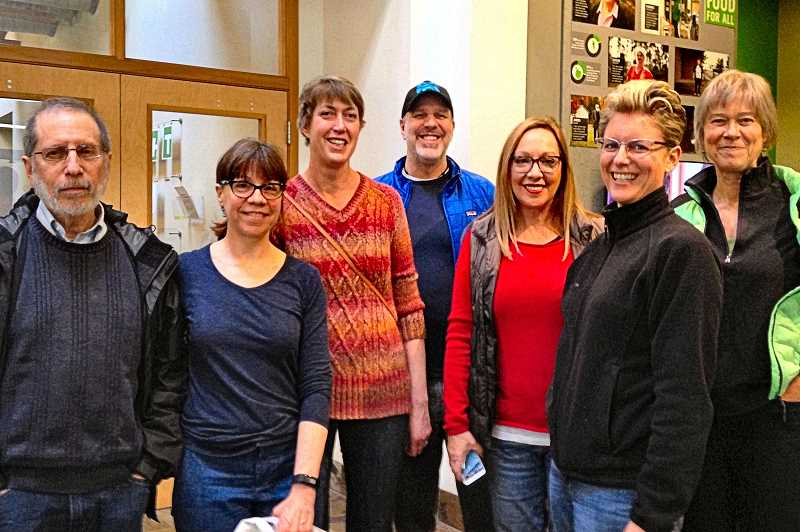 Among the volunteers at the Oregon Food Bank on April 8 were, from left, Marty Ringle, Noelwah Netusil, Cathy Murray, Eric Kinser, Michelle Maida, Fluid Movement proprietor Anne McCranie, and Marnie Frank.
